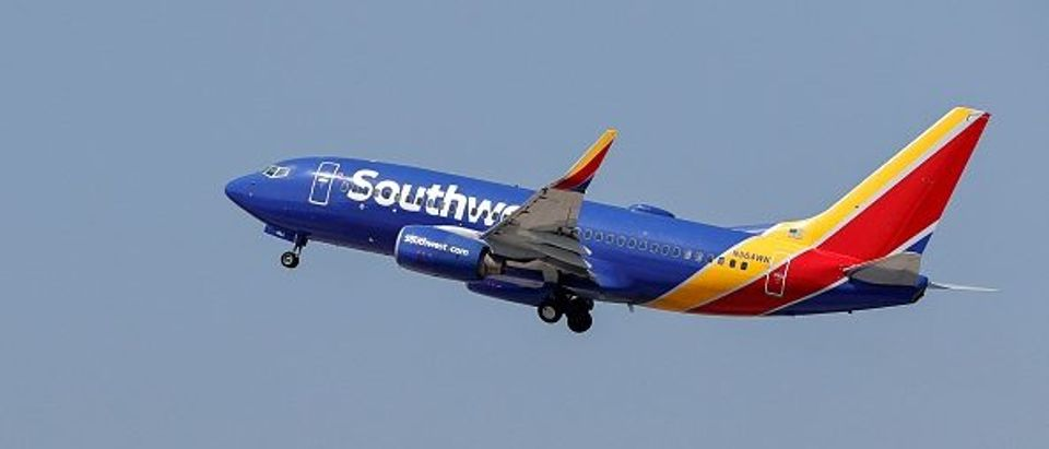 A Southwest Airlines plane takes off from Midway International Airport in Chicago. (Photo by Kamil Krzaczynski. Getty.)
