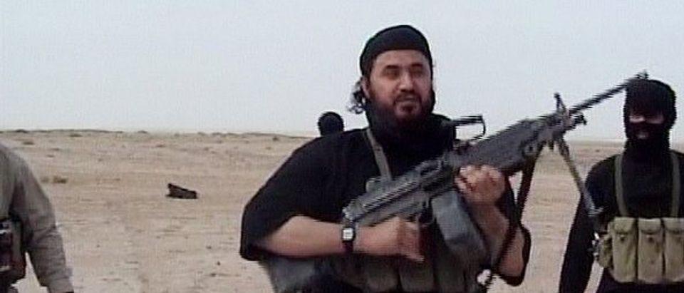 Abu Musab al-Zarqawi, purportedly the leader of al-Qaida in Iraq, holds a machine gun (Photo by U.S. Department of Defense via Getty)