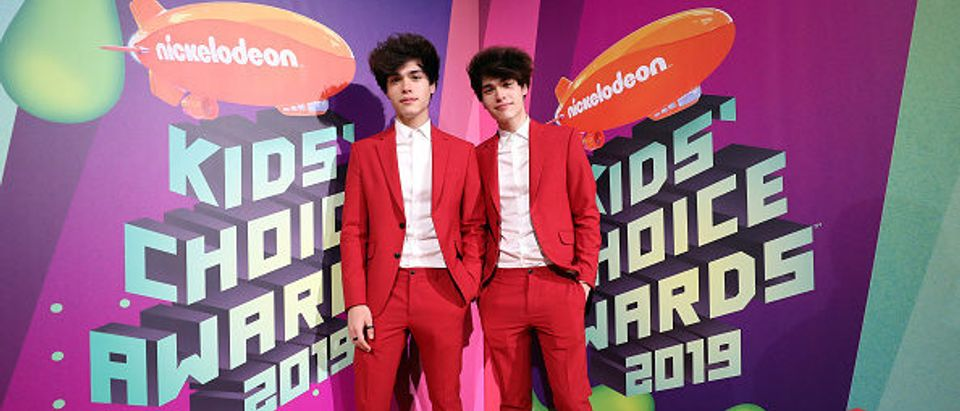 Alan Stokes (L) and Alex Stokes attend Nickelodeon's 2019 Kids' Choice Awards in Los Angeles. (Photo by Rich Fury. Getty Images)