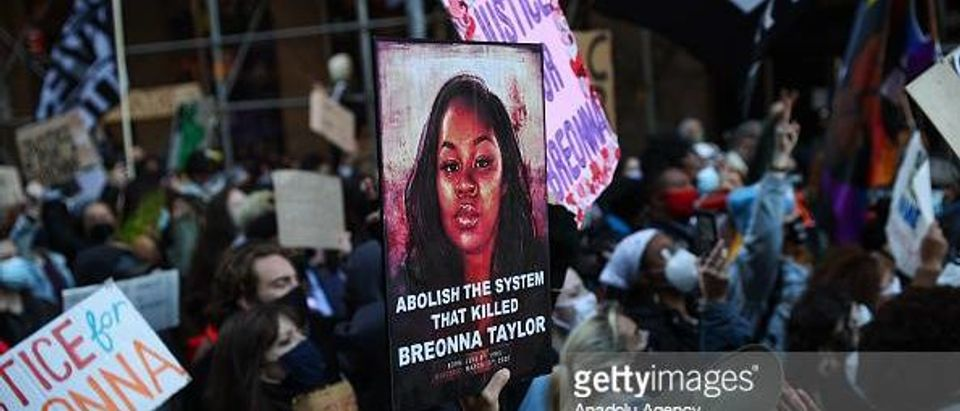 BLM protesters gather in Times Square and march for Breonna Taylor in New York City on March 13, 2021 (Photo by Tayfun Coskun at Anadolu Agency via Getty Images)