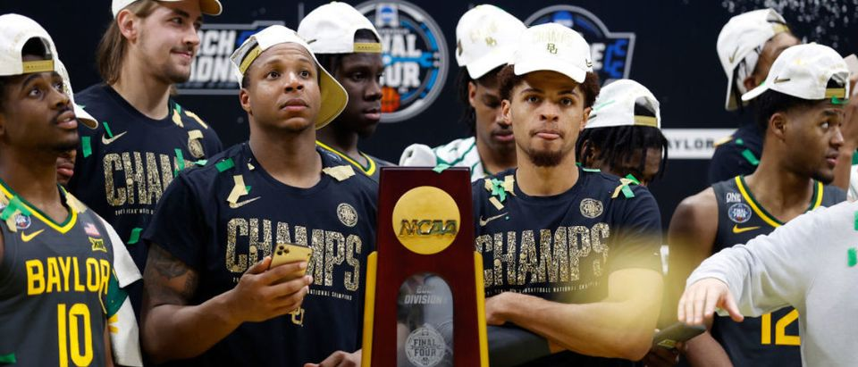 INDIANAPOLIS, INDIANA - APRIL 05: Mark Vital #11 and MaCio Teague #31 of the Baylor Bears look on with the trophy after defeating the Gonzaga Bulldogs 86-70 in the National Championship game of the 2021 NCAA Men's Basketball Tournament at Lucas Oil Stadium on April 05, 2021 in Indianapolis, Indiana. (Photo by Jamie Squire/Getty Images)