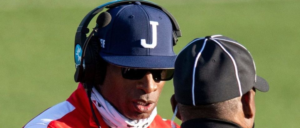 March 20, 2021; Montgomery, AL, USA; Jackson State head coach Deion Sanders talks with the umpire against Alabama State in second half action at Hornet Stadium on the ASU campus in Montgomery, Ala., on Saturday March 20, 2021. Mandatory Credit: Mickey Welsh-USA TODAY NETWORK via Reuters
