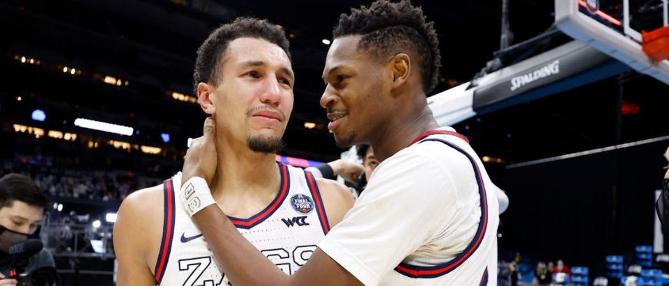 INDIANAPOLIS, INDIANA - APRIL 03: Jalen Suggs #1 reacts with Joel Ayayi #11 of the Gonzaga Bulldogs after defeating the UCLA Bruins 93-90 in overtime during the 2021 NCAA Final Four semifinal at Lucas Oil Stadium on April 03, 2021 in Indianapolis, Indiana. (Photo by Jamie Squire/Getty Images)