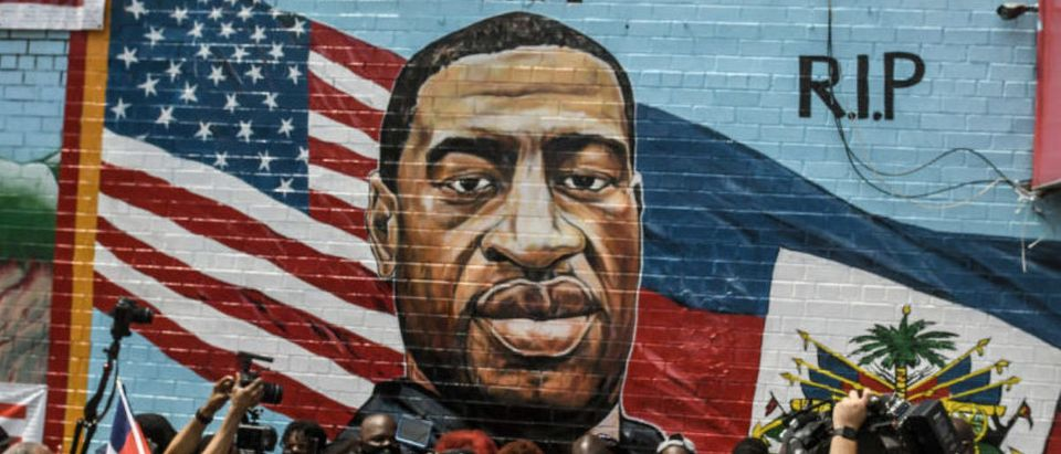 NEW YORK, NY - JULY 13: A mural painted by artist Kenny Altidor depicting George Floyd is unveiled on a sidewall of CTown Supermarket on July 13, 2020 in the Brooklyn borough New York City. George Floyd was killed by a white police officer in Minneapolis and his death has sparked a national reckoning about race and policing in the United States. (Photo by Stephanie Keith/Getty Images)