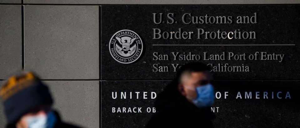 People exit a pedestrian crossing at the US Customs and Border Protection (CBP) San Ysidro Port of Entry at the US Mexico border on February 19, 2021 in San Diego, California. (PATRICK T. FALLON/AFP via Getty Images)