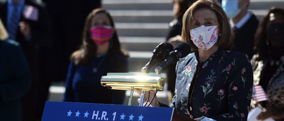 """Speaker of the House Nancy Pelosi, Democrat of California, speaks at an event on the steps of the US Capitol for the """"For The People Act of 2021"""" in Washington, DC, on March 3, 2021. (ERIC BARADAT/AFP via Getty Images)"""