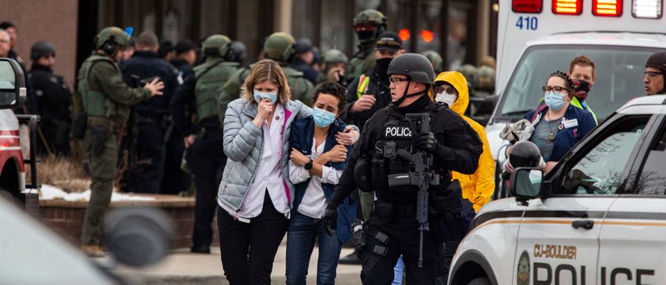 Healthcare workers walk out of a King Sooper's Grocery store after a gunman opened fire on March 22, 2021 in Boulder, Colorado. (Chet Strange/Getty Images)