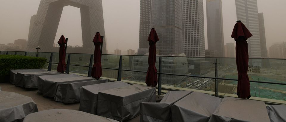 Tables are seen with dust covers at an outdoor restaurant in the central business district during a sandstorm in Beijing on April 15, 2021. (Photo by Greg Baker/AFP via Getty Images)