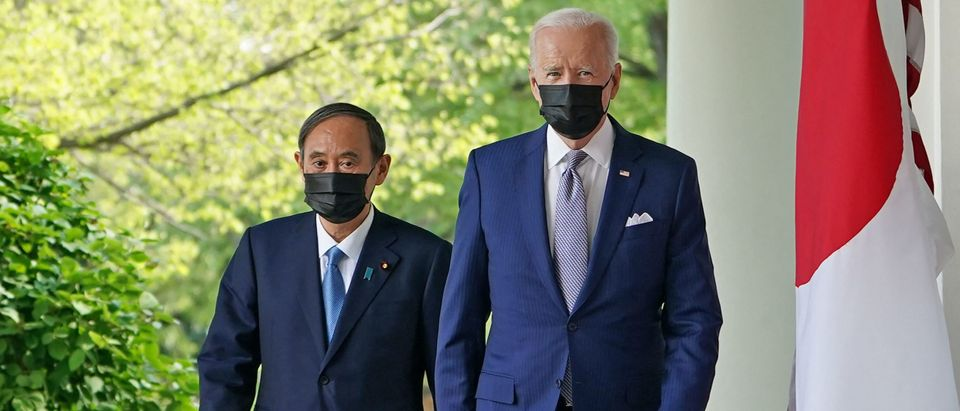 US President Joe Biden and Japan's Prime Minister Yoshihide Suga walk through the Colonnade to take part in a joint press conference in the Rose Garden of the White House in Washington, DC on April 16, 2021. (Photo by MANDEL NGAN/AFP via Getty Images)