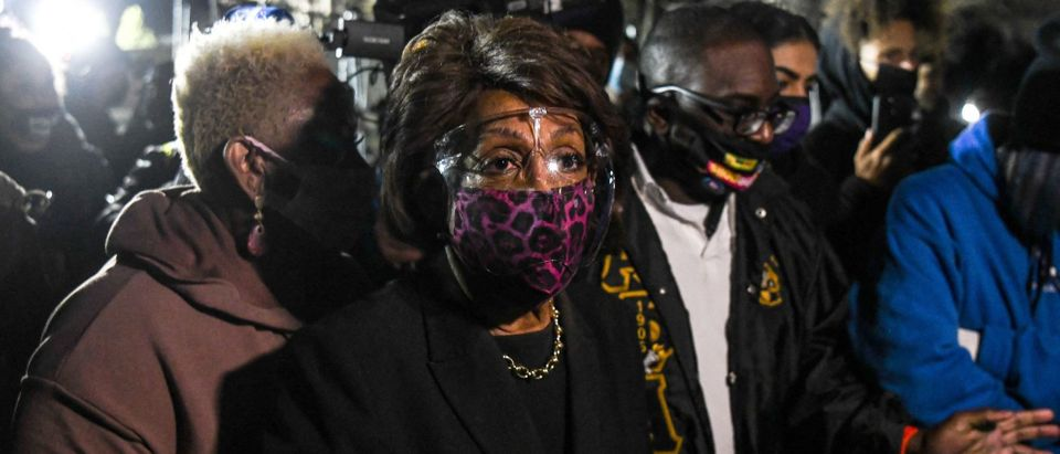 Representative Maxine Waters(C) (D-CA) speaks to the media during an ongoing protest at the Brooklyn Center Police Department in Brooklyn Centre, Minnesota on April 17, 2021. - Police officer, Kim Potter, who shot dead Black 20-year-old Daunte Wright in a Minneapolis suburb after appearing to mistake her gun for her Taser was arrested April 14 on manslaughter charges. (Photo by CHANDAN KHANNA / AFP) (Photo by CHANDAN KHANNA/AFP via Getty Images)