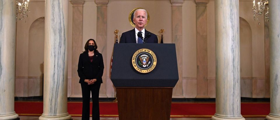Vice President Kamala Harris (L) listens as US President Joe Biden delivers remarks on the guilty verdict against former policeman Derek Chauvin at the White House in Washington, DC, on April 20, 2021. - Derek Chauvin, a white former Minneapolis police officer, was convicted on April 20 of murdering African-American George Floyd after a racially charged trial that was seen as a pivotal test of police accountability in the United States. (Photo by BRENDAN SMIALOWSKI/AFP via Getty Images)