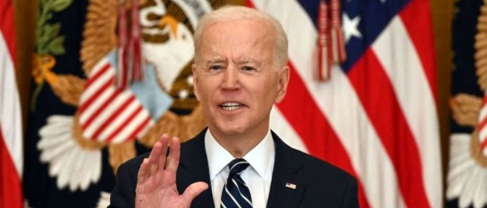 """TOPSHOT - US President Joe Biden answers a question during his first press briefing in the East Room of the White House in Washington, DC, on March 25, 2021. - Biden said Thursday that the United States will """"respond accordingly"""" if North Korea escalates its missile testing. (Photo by JIM WATSON/AFP via Getty Images)"""
