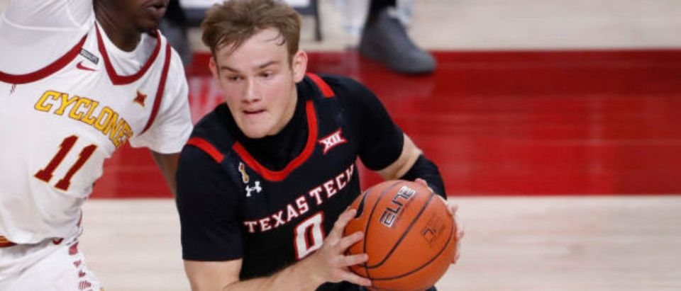 AMES, IA - JANUARY 9: Mac McClung #0 of the Texas Tech Red Raiders drives the ball under pressure from Dudley Blackwell #11 of the Iowa State Cyclones in the second half of play at Hilton Coliseum on January 9, 2021 in Ames, Iowa. The Texas Tech Red Raiders won 91-64 over the Iowa State Cyclones. (Photo by David Purdy/Getty Images)