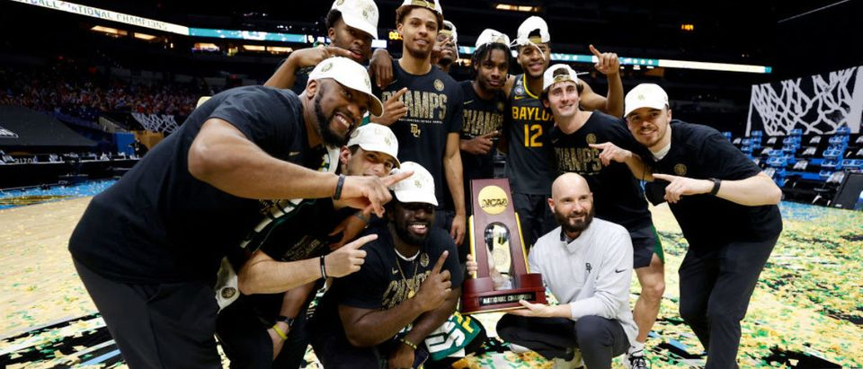 INDIANAPOLIS, INDIANA - APRIL 05: The Baylor Bears pose with the National Championship trophy after winning the National Championship game of the 2021 NCAA Men's Basketball Tournament against the Gonzaga Bulldogs at Lucas Oil Stadium on April 05, 2021 in Indianapolis, Indiana. The Baylor Bears defeated the Gonzaga Bulldogs 86-70. (Photo by Jamie Squire/Getty Images)