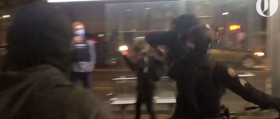 Portland Police Sergeant was punched in the head by a protester Tuesday night [Twitter:Screenshot:The Oregonian]
