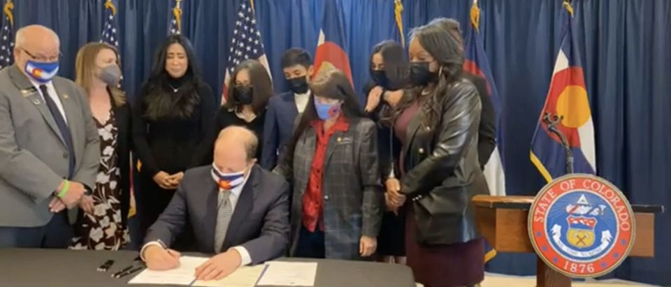 Governor Jared Polis signed two gun safety bills on Monday, April 19, 2021
