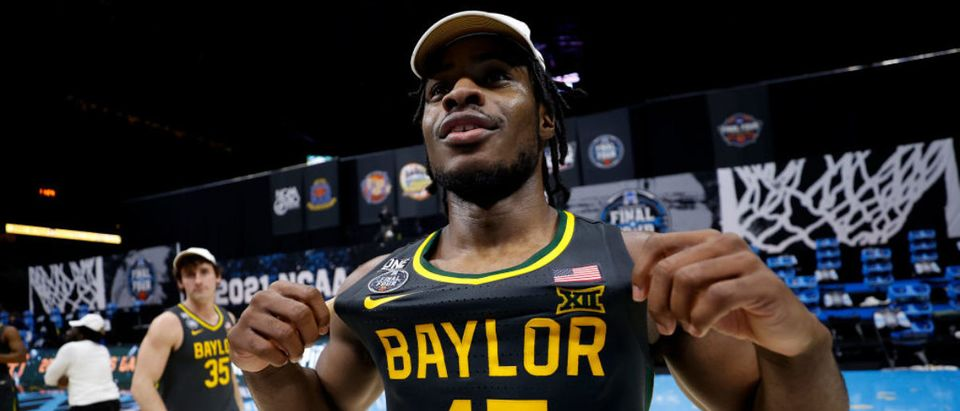 INDIANAPOLIS, INDIANA - APRIL 05: Davion Mitchell #45 of the Baylor Bears celebrates on the court after defeating the Gonzaga Bulldogs 86-70 in the National Championship game of the 2021 NCAA Men's Basketball Tournament at Lucas Oil Stadium on April 05, 2021 in Indianapolis, Indiana. (Photo by Jamie Squire/Getty Images)