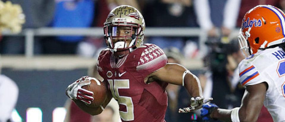 TALLAHASSEE, FL - NOVEMBER 26: Travis Rudolph #15 of the Florida State Seminoles outruns Marcell Harris #26 of the Florida Gators for a 46-yard touchdown in the third quarter of the game at Doak Campbell Stadium on November 26, 2016 in Tallahassee, Florida. Florida State defeated Florida 31-13. (Photo by Joe Robbins/Getty Images)