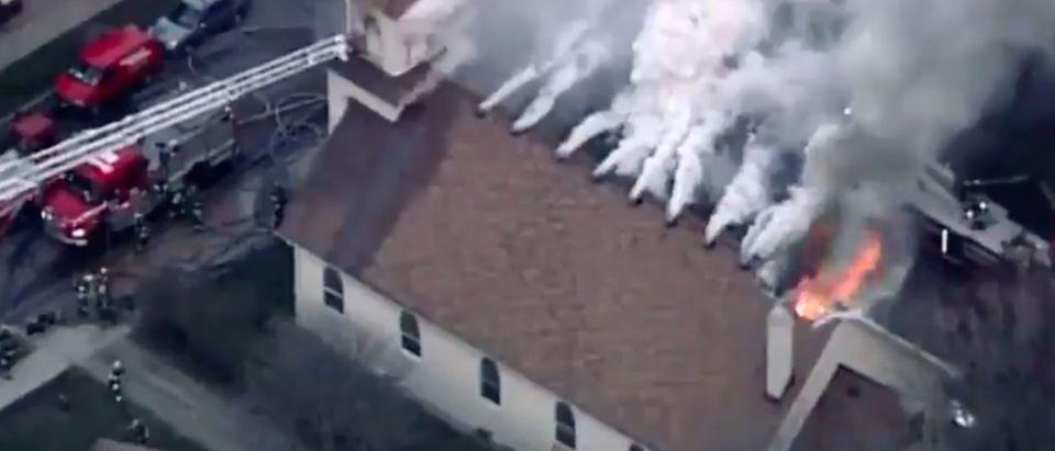 Catholic Church burns. Screenshot, Twitter.