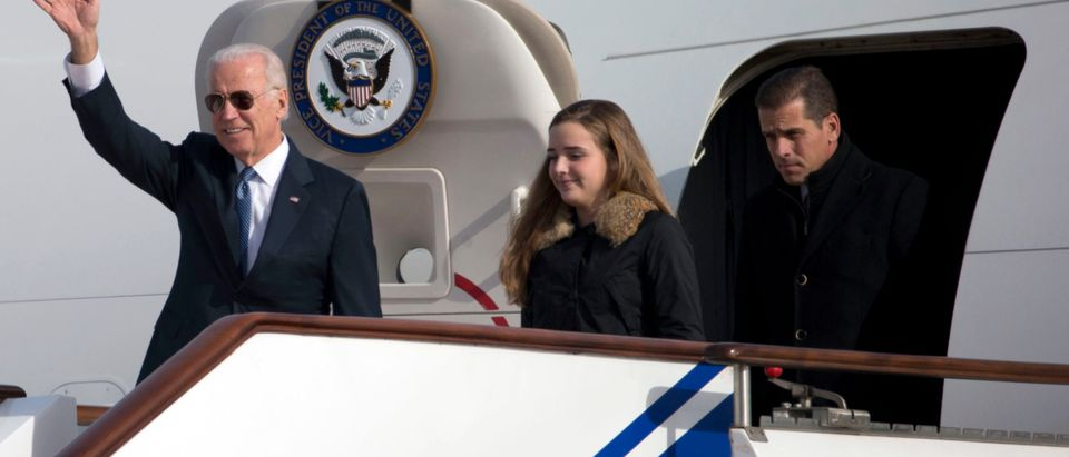 BEIJING, CHINA - DECEMBER 04: U.S. Vice President Joe Biden waves as he walks out of Air Force Two with his granddaughter Finnegan Biden (C) and son Hunter Biden (R) at the airport December 4, 2013 in Beijing, China. Biden is on the first leg of his week-long visit to Asia. (Photo by Ng Han Guan-Pool/Getty Images)
