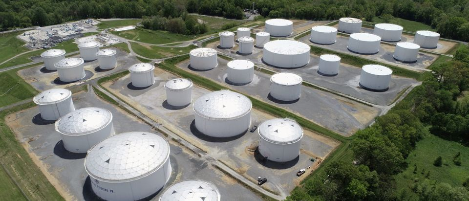 FILE PHOTO: Holding tanks are seen in an aerial photograph at Colonial Pipeline's Dorsey Junction Station in Woodbine, Maryland, U.S. May 10, 2021. (REUTERS/Drone Base/File Photo/File Photo)