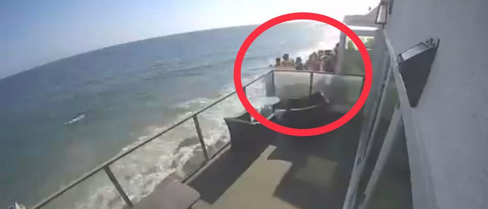 A balcony at a Malibu home collapsed onto the beach Saturday