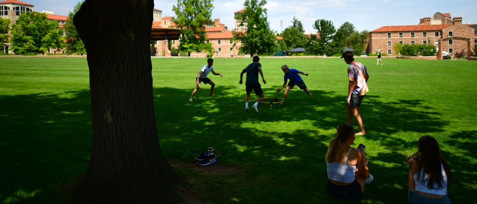 A group of incoming freshmen play spike ball on campus at the University of Colorado Boulder. Photo by Mark Makela. Getty.