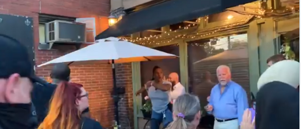 A restaurant patron points his gun at BLM protesters. Hayes Gardner.