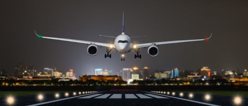 Airplane,Take,Off,/,Landing,At,Night,With,Blurred,Town