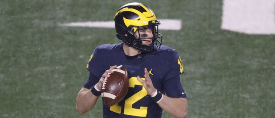 ANN ARBOR, MICHIGAN - NOVEMBER 14: Cade McNamara #12 of the Michigan Wolverines throws a second half past against the Wisconsin Badgers at Michigan Stadium on November 14, 2020 in Ann Arbor, Michigan. (Photo by Gregory Shamus/Getty Images)