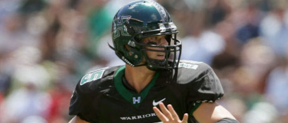 HONOLULU, HI - SEPTEMBER 3: Quarterback Colt Brennan #15 of the University of Hawai'i at Manoa Warriors passes the ball against the University of Southern California Trojans at Aloha Stadium on September 3, 2005 in Honolulu, Hawaii. The Trojans won 63-17. (Photo by Harry How/Getty Images)