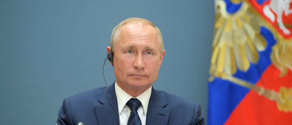 Russian President Vladimir Putin attends by a video conference a trilateral meeting with the leaders of Iran and Turkey on the topic of Syria, in Moscow on July 1, 2020. (ALEXEY DRUZHININ/SPUTNIK/AFP via Getty Images)