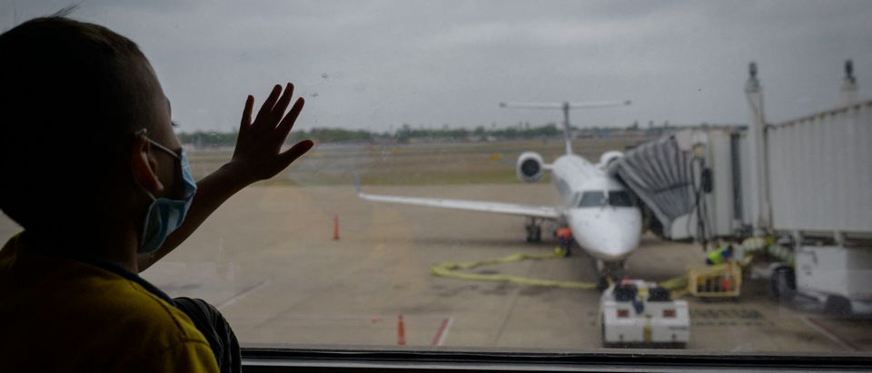 Migrant Child Looks At Plane