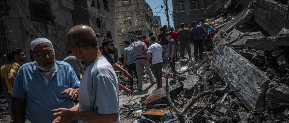 Palestinians inspect damage to buildings in Gaza City on May 20, 2021 in Gaza City, Gaza. (Fatima Shbair/Getty Images)