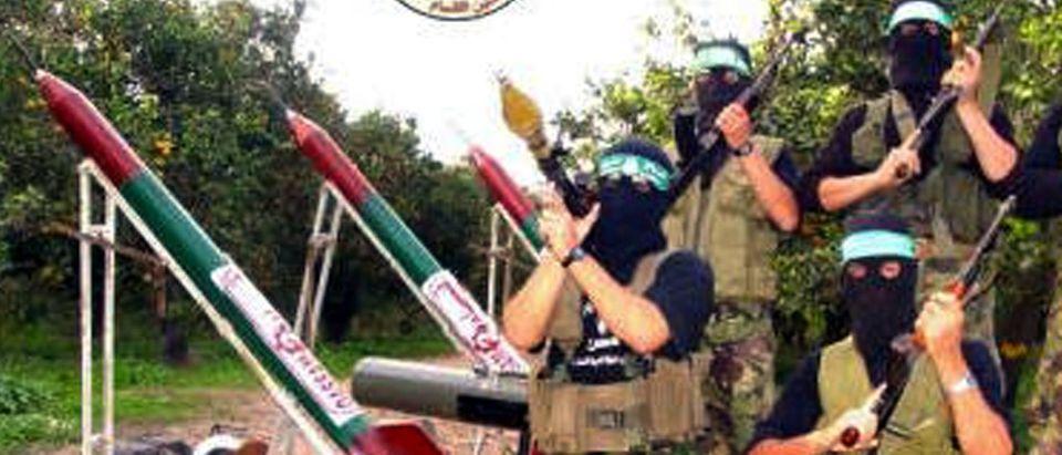Hamas Distributes Images As Militants Pose With Qassam Rockets