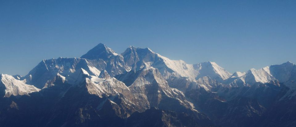 FILE PHOTO: Mount Everest, the world highest peak, and other peaks of the Himalayan range are seen through an aircraft window during a mountain flight from Kathmandu