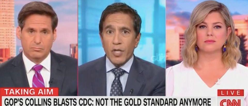 "Sanjay Gupta appears on ""New Day"" with John Berman and Brianna Keilar. Screenshot/CNN"