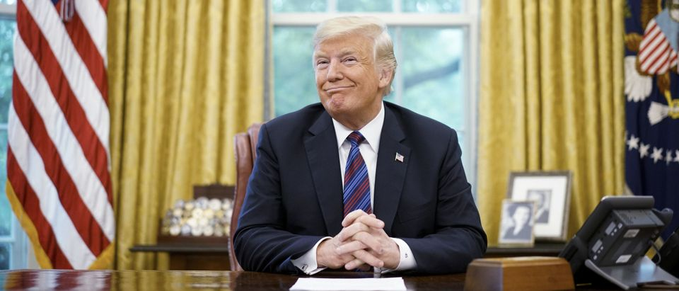 """US President Donald Trump smiles during a phone conversation with Mexico's President Enrique Pena Nieto on trade in the Oval Office of the White House in Washington, DC on August 27, 2018. - President Donald Trump said Monday the US had reached a """"really good deal"""" with Mexico and talks with Canada would begin shortly on a new regional free trade pact.""""It's a big day for trade. It's a really good deal for both countries,"""" Trump said.""""Canada, we will start negotiations shortly. I'll be calling their prime minister very soon,"""" Trump said.US and Mexican negotiators have been working for weeks to iron out differences in order to revise the nearly 25-year old North American Free Trade Agreement, while Canada was waiting to rejoin the negotiations. (Photo by MANDEL NGAN / AFP) (Photo by MANDEL NGAN/AFP via Getty Images)"""