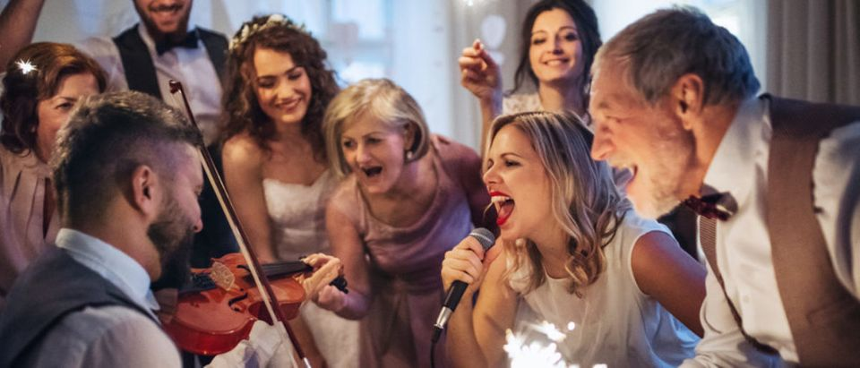 A,Young,Bride,,Groom,And,Other,Guests,Dancing,And,Singing