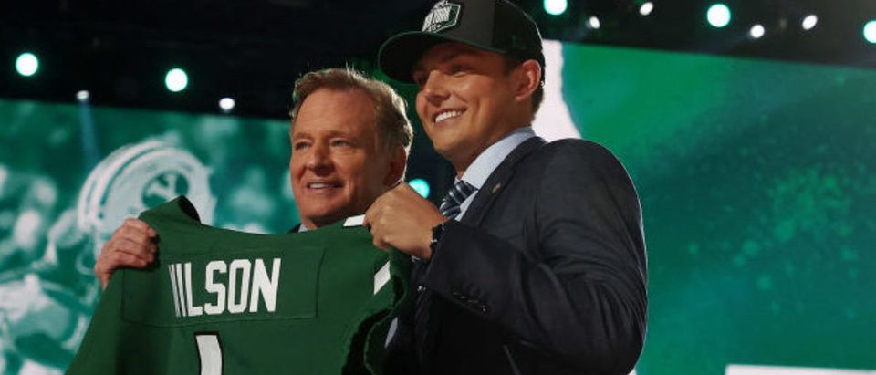 CLEVELAND, OHIO - APRIL 29: Zach Wilson stands onstage with NFL Commissioner Roger Goodell after being drafted second by the New York Jets during round one of the 2021 NFL Draft at the Great Lakes Science Center on April 29, 2021 in Cleveland, Ohio. (Photo by Gregory Shamus/Getty Images)