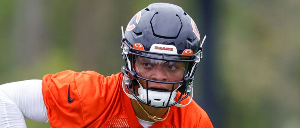 May 15, 2021; Lake Forest, Illinois, USA; Chicago Bears quarterback Justin Fields (1) works out during rookie minicamp at Halas Hall. Mandatory Credit: Kamil Krzaczynski-USA TODAY Sports via Reuters