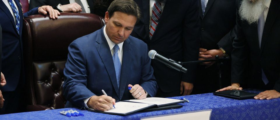 Florida Gov. Ron DeSantis signed HB 529 at the Shul of Bal Harbour on June 07, 2021 in Surfside, Florida. (Photo by Joe Raedle/Getty Images)