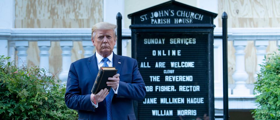 US President Donald Trump holds a Bible while visiting St. John's Church across from the White House after the area was cleared of people protesting the death of George Floyd June 1, 2020, in Washington, DC. - US President Donald Trump was due to make a televised address to the nation on Monday after days of anti-racism protests against police brutality that have erupted into violence. The White House announced that the president would make remarks imminently after he has been criticized for not publicly addressing in the crisis in recent days. (Photo by Brendan Smialowski/AFP via Getty Images)