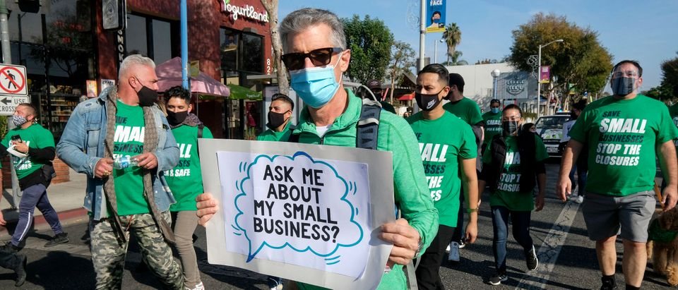 Members of small business owners take part in a 'Save Small Business' protest in Los Angeles, California on December 12, 2020. (Photo by RINGO CHIU/AFP via Getty Images)