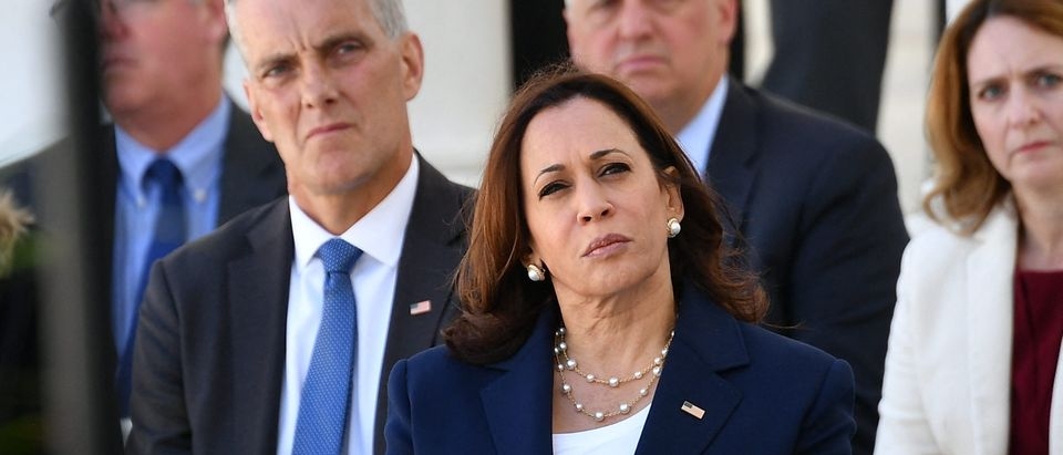 US Vice President Kamala Harris listens as US President Joe Biden delivers an address at the 153rd National Memorial Day Observance at Arlington National Cemetery on Memorial Day in Arlington, Virginia on May 31, 2021. (Photo by Mandel Ngan/AFP via Getty Images)