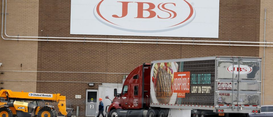 Outside of a JBS meat packing plant. (Photo by JEFF KOWALSKY/AFP via Getty Images)