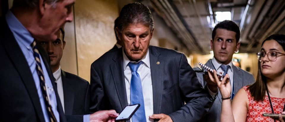 U.S. Sen. Joe Manchin (D-WV) leaves a bipartisan meeting on infrastructure in the basement of the U.S. Capitol building after the original talks fell through with the White House on June 8, 2021 in Washington, DC. (Samuel Corum/Getty Images)