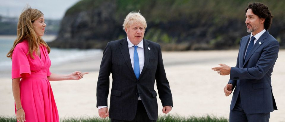 G7 Leaders Meet And Bump Elbows On A Windy Beach