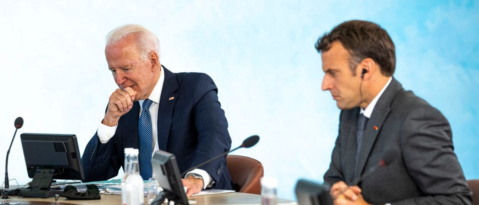 US President Joe Biden (L) and France's President Emmanuel Macron attend a plenary session at the G7 summit in Carbis Bay, Cornwall on June 13, 2021. (DOUG MILLS/POOL/AFP via Getty Images)