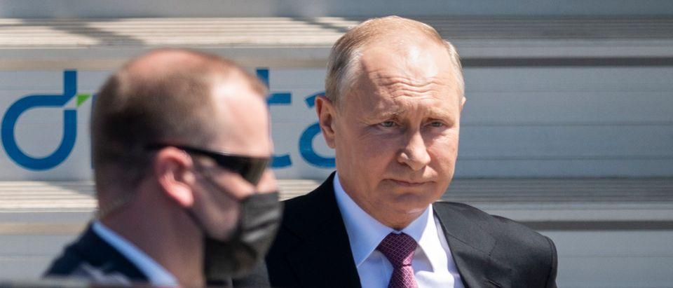 Russia's President Vladimir Putin disembarks from his Iljuschin Il-96 airplane at Geneva Airport Cointrin for the U.S.-Russia summit at Villa La Grange on June 16, 2021 in Geneva, Switzerland. (Alessandro della Valle - Pool/Keystone via Getty Images)
